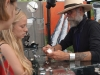 A metal worker and jewelry artist explains his creative process to STA senior Mary Campbell at the 2016 Brookside Art Fair. photo by Violet Cowdin