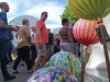 Brookside Art Fair attendents walk by glass sculptures as they browse the wide selection of art. photo by Violet Cowdin