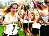 "Junior Audrey Muehlebach jogs by her teammates after passing a routine stick check. ""[Lacrosse] is really demanding physically and mentally, but it'€™s just too fun to give up,"" Muehlebach said. by Maggie Allen"