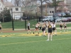 The STA and LSHS lacrosse teams take the field before the draw of the game. by Maggie Allen