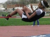 Freshman Maya Charles narrowly brushes the bar during her high jump at the Central Relays April 15. by Kennedy Bright