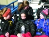 Seniors Hannah McCausland, Courtney Coppinger, sophomore Ann Campbell and freshman Emily Laird try to keep warm while having a laugh at the KU Memorial Stadium April 19. by Kennedy Bright