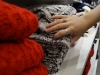 An STA student reaches for a sweater at Forever 21 during Black Friday shopping Nov. 27. photo illustration by Violet Cowdin