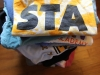 Hundreds of dollars worth of STA spirit wear and merchandise sits in a pile. photo illustration by Maggie Knox