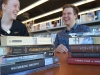 St. Teresa's senior, Grace Girardeau, and Rockhurst senior, Trey Hunt, laugh and chat at the Plaza Library. Some of their shared required reading includes, The Great Gatsby, Brave New World, and The Adventures of Huckleberry Finn. photo by Violet Cowdin