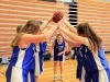 Junior Grace Laird prepares to run through a tunnel her teammates create. The tunnel was created to celebrate Laird's win in a knockout game at the team's first practice Nov. 30 in the Goppert Center. photo by Sophie Sakoulas