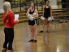 Dance captain Katie Daniels, center, laughs as coach Christina Monaco explains a new revision to a routine Nov. 4. Daniels is the main dance team captain along with co-captains Camille Porterfield, right, and Katherine Viviano, not shown.