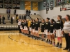 The varsity basketball Stars hold hands during the National Anthem before their game Friday at Raymore-Peculiar High School. photo by Maggie Knox