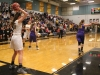 Senior Grace Kitts, left, prepares to throw the ball in during the third quarter of the District Championship game Friday. The Stars lost the game 44-40 to Belton High School but finished their season with a 21-5 record. photo by Maggie Knox