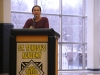 STA volleyball coach Lauren Mathewson talks about her experiences coaching seniors Maddie Torti and Emma Runyan this fall at the college signing ceremony Feb. 3. This season, the volleyball team won second place in the State tournament with the help of Torti and Runyan. photo by Maggie Knox