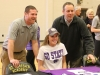 Senior Maddy Russell, center, poses with STA athletic directors Tyler Abney, left, and Mark Hough after signing her National Letter of Intent to play soccer at Kansas State University this fall. photo by Maggie Knox