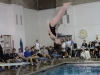 Armstrong is doing a backflip. She qualified at the Lee's Summit R-7 Holiday Splash meet. photo by Libby Hutchinson