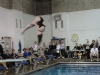 Armstrong preforms a flip, she has been the first STA diver to qualify for state in ten years. photo by Libby Hutchinson