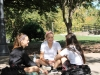 Juniors Sarah Schaefer, Layne Stowers and Helayna James talk in the quad at St. Teresa's Academy on Oct. 17. Photo by Meghan Baker.