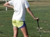 Junior Jessie Culver leans on her golf club to rest during practice Sept. 10 at Heart of America Golf Course. The team practiced their swings before meeting in the club house to discuss plans for the season.