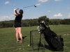 Junior Suzie Fiss takes a swing during golf practice Sept. 10 at Heart of America Golf Course. The team is working on recruiting new members for the next season.