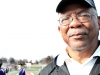 "STA track coach Richard Samuels gives advice to girls before their events at the track invitational held at Bishop Miege High School April 5. ""€œI'€™m enjoying the track season and having fun. I'€™m looking forward to bigger and better things as this season progresses."" by Viridiana Hernandez"