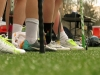 Cleats and sticks line the field as players wait to go onto the field at their lacrosse game Saturday April 6. Unlike other sports players, the STA lacrosse players did not ever sit on the bench, the girls stood equipped and ready to go. by Katie Hornbeck