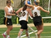 Freshman Maggie Hodes, left, and junior Mady Sargent, right, rush to congratulate their star goalie, Maggie Allen, at half time in their lacrosse game against the Lee'€™s Summit Tigers Tuesday April 9. Allen led her team to victory with a shutout. by Katie Hornbeck
