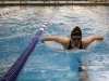 Junior Claire McCann swims butterfly during the 200 yard I.M. She finished sixth. McCann also swam the 100 yard butterfly, where she got third. photo by Mary Hilliard