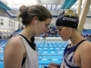 Freshmen Molly Cowan, left, and Caroline Stuckey listen to music before ILCs begins. Cowan competed in the 100 backstroke and Stuckey competed in 200 freestyle and 100 backstroke. photo by Mary Hilliard