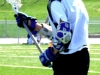 Freshman Wheaton Jackoboice catches a pass at practice April 12. The Rockhurst Lacrosse team is led by coaches Tim Reidy, Brad Tharpe, Tim Hannon and Mark Bayhylle. by Claire Jefferson