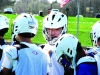 By Claire Jefferson: Sophomore Kyle Savage converses with sophomore Joseph Giwa after finishing a line drill Apr. 12. The Hawklets play in the Lacrosse Association of Kansas City region, or LAKC.