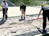 Sophomores Haley Sirokman, Katie Grasse, and Freshman Claire Reboulet rake the pits in between each jump at the STA home meet on April 5. The girls all ran in races after helping out with the field events of the meet. by Giggy Reardon