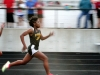 Sophomore Kennedy Bright runs the 100 meter dash at the Bishop Miege Track Meet on April 6. Last season Bright broke the record for the 100 meter dash and competed at the state meet. by Giggy Reardon