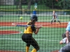 Senior Elaina Bailey swings at the ball, she scored a home run at the game Sept. 23.