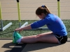 Senior Ceci Ismert stretches before track practice March 11. photo by Mary Hilliard