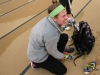 Senior Anna Meagher ties her cleats before lacrosse tryouts March 2. The lacrosse team held tryouts throughout the week of March 2-6. photo by Mary Hilliard