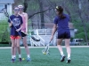Senior Kristina Coppinger, right, passes off the ball to senior Ellie Petree, left, at varsity lacrosse practice March 30. photo by March 30