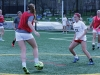 Senior Abby Small, center, dribbles the ball away from junior Meghan Schmidt during a game at varsity soccer practice March 30. photo by Maggie Knox