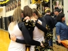 Senior members of the STA dance team huddle together after their last dance at St. Teresa's. The dance team preformed at halftime and celebrated senior night Feb. 24. photo by Kat Mediavilla