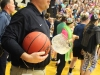 Athletic director Mark Hough waits on the sidelines seconds before the end of the STA basketball game to award the Stars with the Irish Cup. The Stars defeated Sion 62-40 Feb. 24. photo by Kat Mediavilla