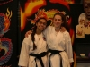 Sophomores Talia Parra, left, and Olivia Robertson pose for a photo after their karate lesson. The girls received their black belts during their practice Oct. 15. photo by Gabby Martinez