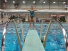 Junior Sophia Prochnow prepares to dive off the board at dive team practice Nov. 19 at Longview Recreation Center. Prochnow is the dive team captain. photo by Meg Thompson