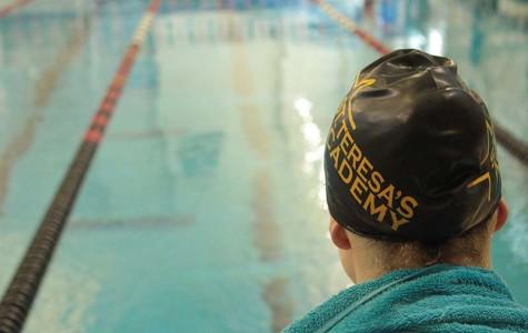 Swim team breaks three school records at State