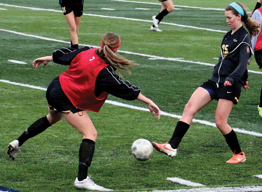 Junior Grace Kitts warms up with a possession drill with her team March 23. photo by Lauren Zastrow