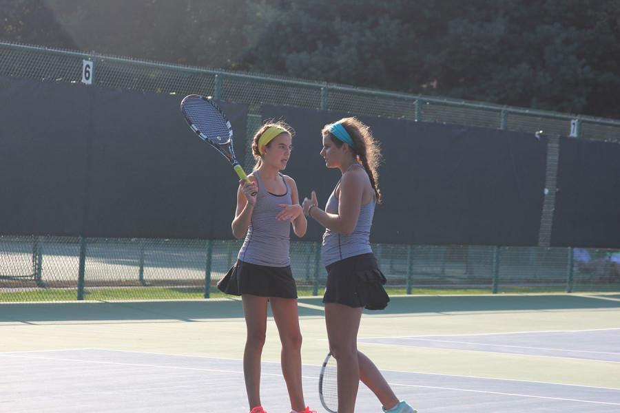 Members+of+the+tennis+team+practice+to+prepare+for+upcoming+tournaments.+photo+compiled+by+Clare+Kenney