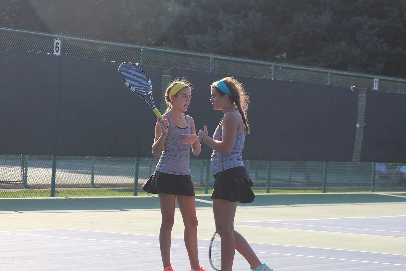Members of the tennis team practice to prepare for upcoming tournaments. photo compiled by Clare Kenney
