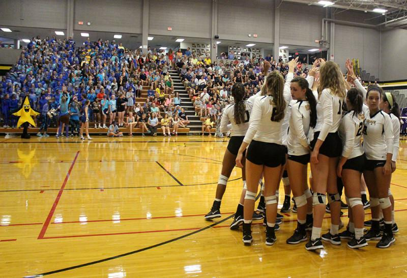 The STA varsity volleyball team huddles up during a timeout during their home game against Sion Sept. 16. The Stars would go on to finish 2nd in the class 4 MSHSAA state tournament. photo by Kat Mediavilla