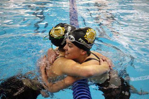 Swim and dive wins league championship