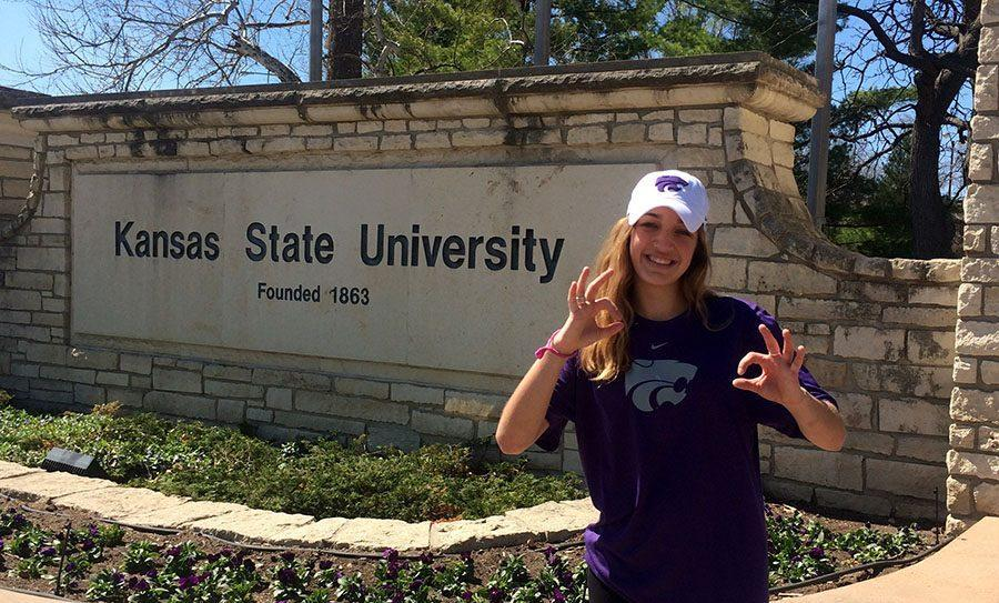 Junior+Jacque+Smith+poses+in+her+new+K-State+gear+in+front+of+her+new+college%27s+sign.+photo+courtesy+of+Jacque+Smith