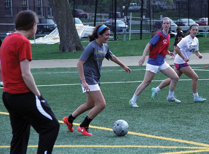 Junior+Macy+Trujillo+dribbles+the+ball+towards+the+goal+during+varsity+soccer+practice+March+30.+photo+by+Maggie+Knox