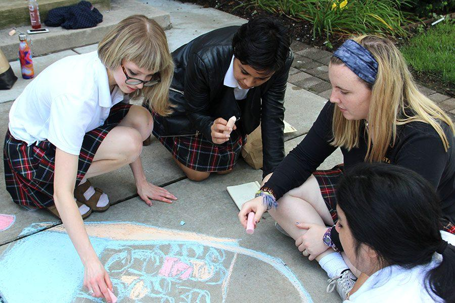 Senior+Ellie+Grever%2C+from+left%2C+junior+Yasmeen+Mir+and+junior+Annie+Mullen+contribute+to+their+advisory%27s+chalk+drawing.+Grever%2C+Mir+and+Mullen+are+members+of+the+Reynolds+advisory.+photo+by+Anna+Louise+Sih