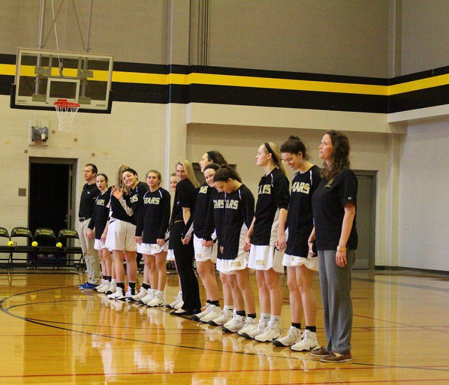 The+Varisity+basketball+team+stands+in+line+for+The+National+Anthem.+photo+courtesy+of+Olivia+Woodbury