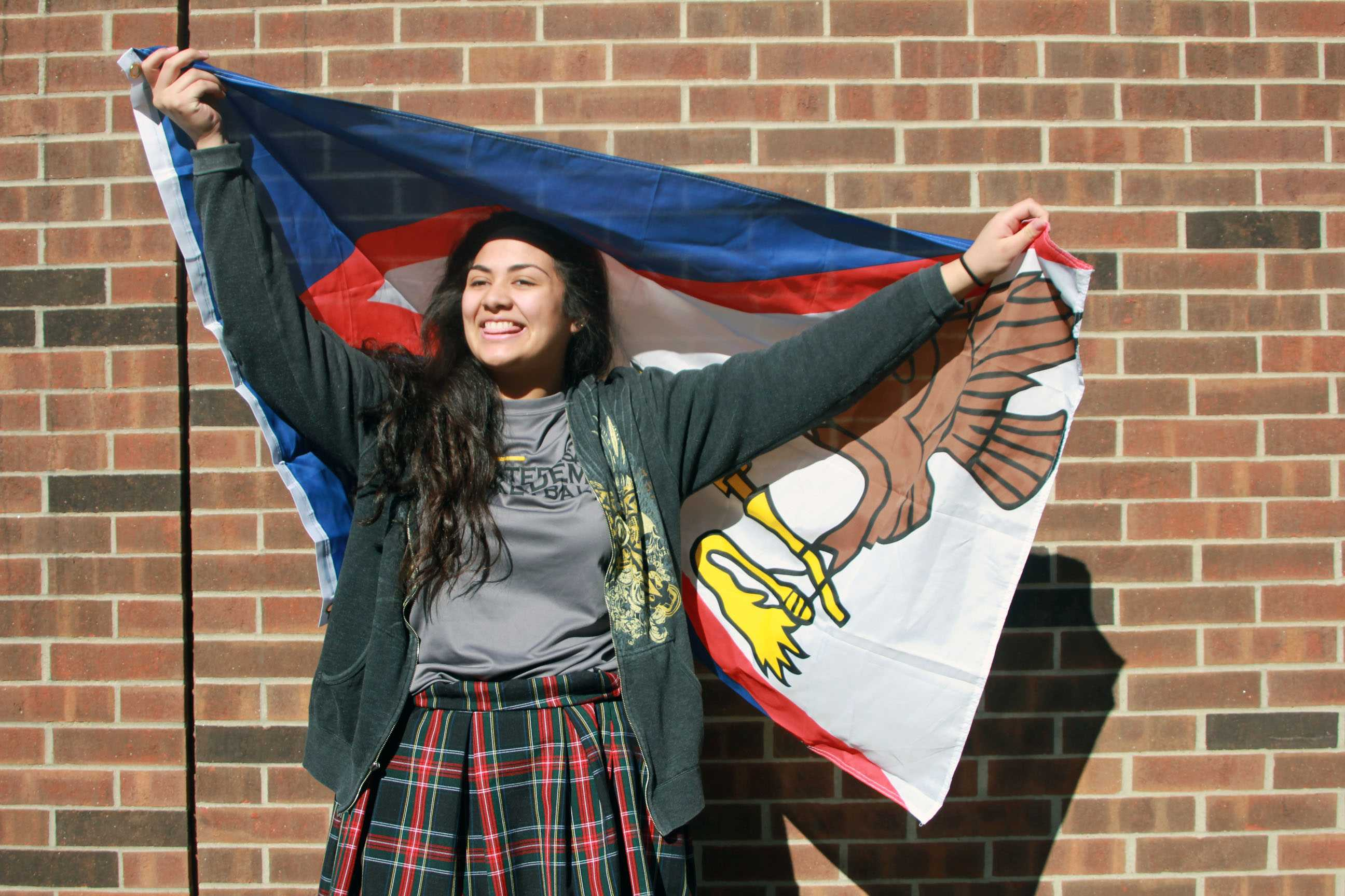 Freshman Cadina Palelei poses with the island of Samui flag. Samui is the second largest island in the gulf of Thailand. photo by Helen Krause