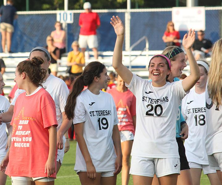 The STA soccer team celebrates their win after the State Semifinals at Swope Park on June 3. The team competed in the State Finals the next day. photo by Margaret Queen